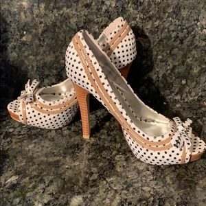 Size 6 peep toe heels by Not Rated.
